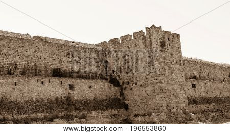big old wall of ancient stone fortress tone sepia