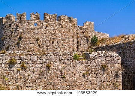 ancient ruins of big stone fortress against the background of the clear sky