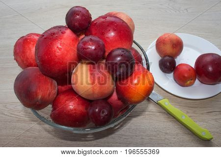 Ripe fruit on the table. Peaches nectarine plums. Beautiful sweet peaches nectarine and plums