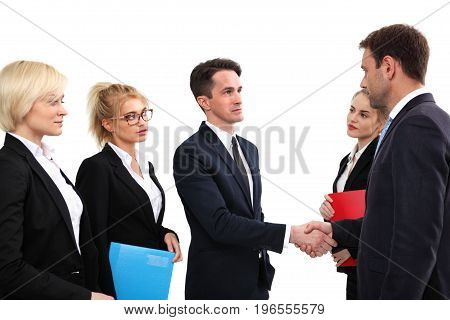 Business people shaking hands finishing up a meeting isolated on white background