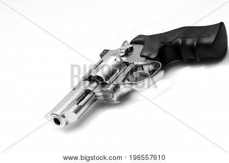 Beautiful revolver lies on a white background