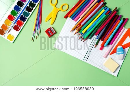 School background. Various school supplies on a desktop, copy space, top view