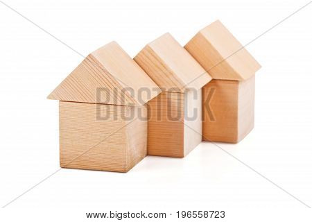Toy houses made of wooden cubes isolated on white background