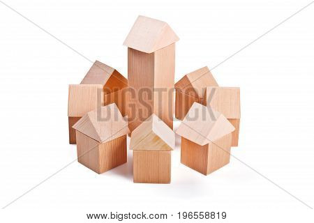 City and suburbs. Toy houses made of wooden cubes isolated on white background