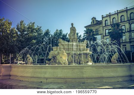 Water Fountain With A Statue In A Main Square In Seville, Spain, Europe