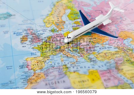 Travel to europe by plane background. Plane on map closeup. Vacation and business trip conconcept