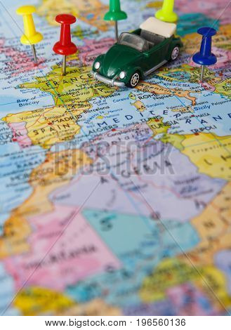 Travelling abroad by car concept. Visited countries tackled with pins on the map. Focus on europe. Tourism and vacation background, closeup