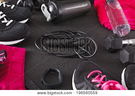Fitness female outfit background top view. Set of sport clothing and equipment for women, active lifestyle, body care concept