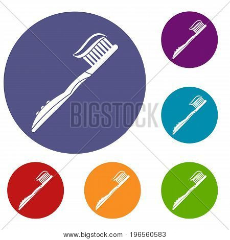 Toothbrush with toothpaste icons set in flat circle red, blue and green color for web