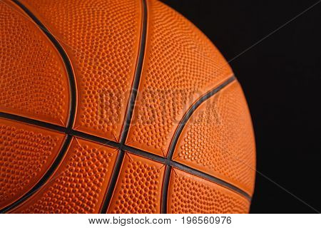 Basketball ball on black background closeup. Active game, healthy lifestyle, streetball concept
