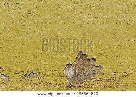 Texture of old antique vintage crackled yellow wall. Closeup. Toning.