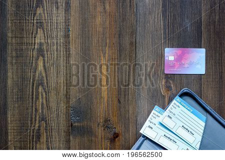 Buy tickets for travel. Tickets on wooden table background top view.