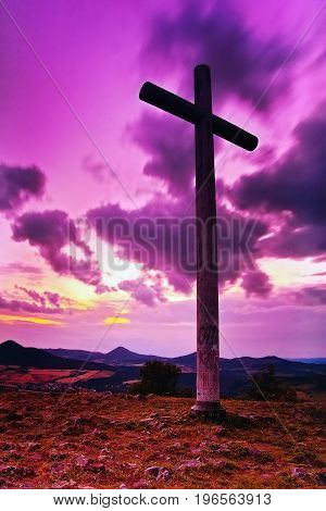 Big Christian Cross Standing On Top Of A Hill Radobyl  In Chko Ceske Stredohori Area At Evening Afte