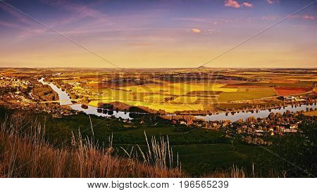 Sunset Panoramatic View From Radobyl Hill To River Labe, Golden Fields, Hill Rip On Horizont And Cit
