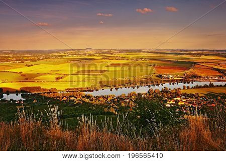 Sunset View From Radobyl Hill To European River Labe, Golden Fields, Hill Rip On Horizont And Cities