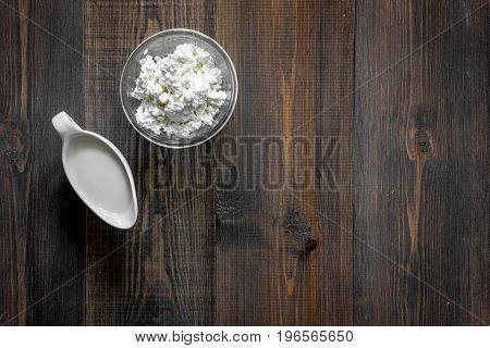 Farm products on dark wooden background top view.