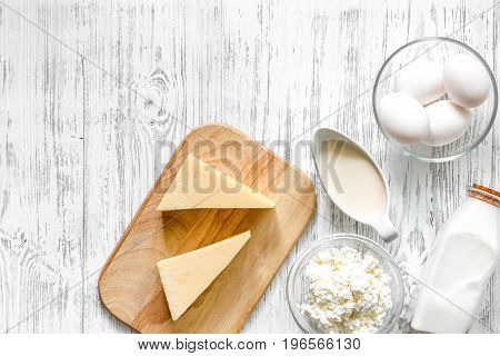 Farm products on wooden background top view.