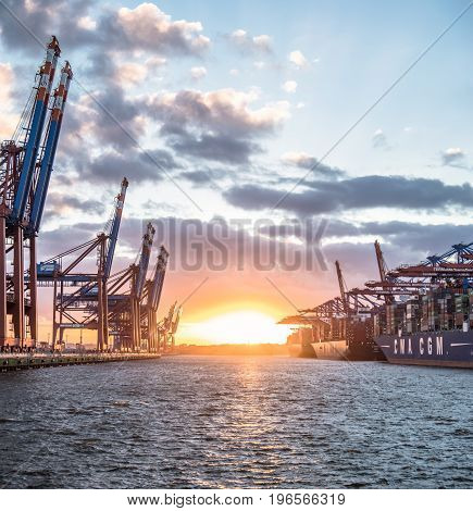 HAMBURG , GERMANY - JULY 12 2017: Container gantry cranes of the terminal Eurogate and Burchardtkai getting ready for unloading ships in the deepwater port Hamburg-Waltershof