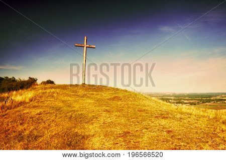 Big Christian Cross Standing On Top Of A Hill Radobyl  In Chko Ceske Stredohori Area At Evening In C