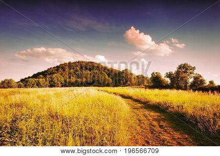 Field Path Leading To The Hill To Radobyl Hill In Protected Landscape Areas Ceske Stredohori In Czec