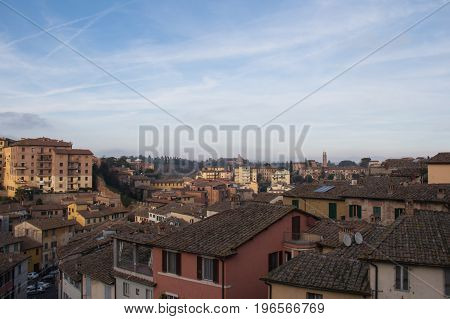 Siena cityscape. The view of typical buildings and blue sky in a sunny day.