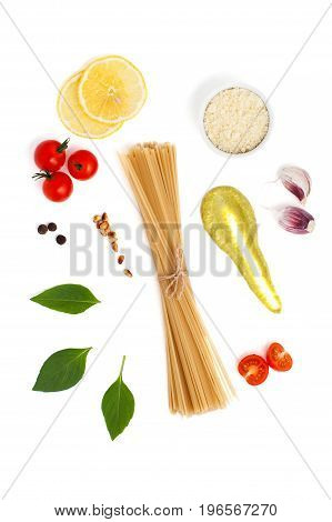 Set Of Ingredients For Cooking Spaghetti With Pesto Sauce And Tomatoes On A White Background..