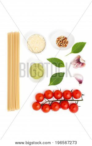A Set Of Ingredients For Cooking Pasta With Pesto Sauce And Tomatoes On A White Background.