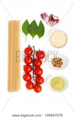 Set For Cooking Pasta With Pesto Sauce And Tomatoes On A White Background..