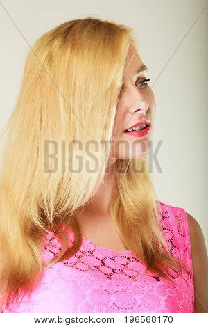 Dyeing hairstyling beauty concept. Closeup of beautiful dyed blonde woman hair. Studio shot on grey background