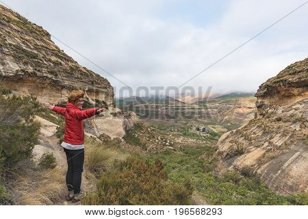 Tourist Standing With Outstretched Arms And Looking At The Panoramic View In The Majestic Golden Gat