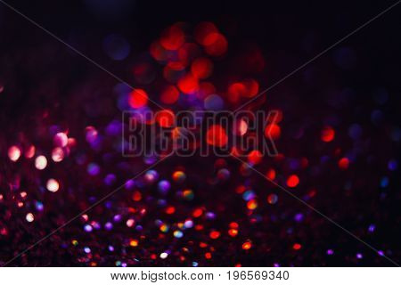 Abstract blurred glittering shine background, mixed color halo. Blur light bokeh. Christmas wallpaper decorations concept. New year holiday festive backdrop. Sparkle circle celebrations display.