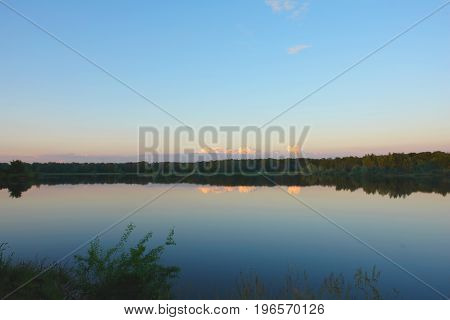 Beautiful sky over lake with still water