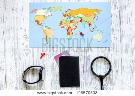 Planning trip. World map on wooden table background top view.