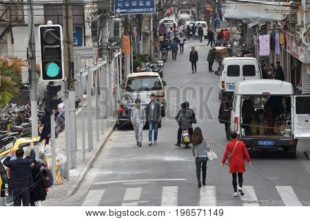 SHANGHAI CHINA - MARCH 20: Shanghai street on March 20 2016 in Shanghai China. Shanghai is the largest Chinese city by population.