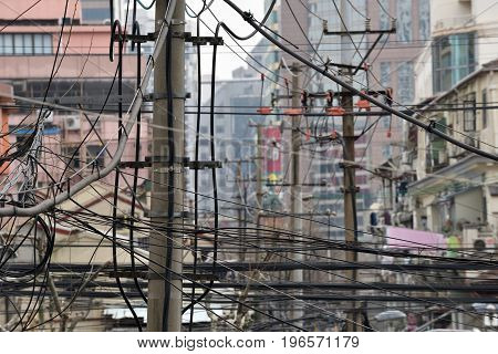 The chaos of cables and wires on street in Shanghai China.