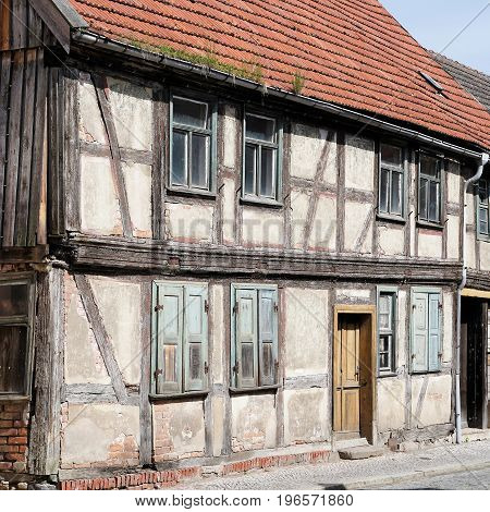 Old dilapidated unused half-timbered house in the old town of Tangermuende in Germany
