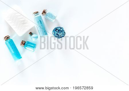 Spa set with sea salt, blue clay and lotion on white background top view.