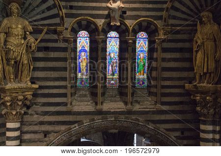 Italy Siena - December 26 2016: the view of the stained glass window of the Siena Cathedral. View of cathedral interior from the passageway under the roof on December 26 2016 in Siena Tuscany Italy.