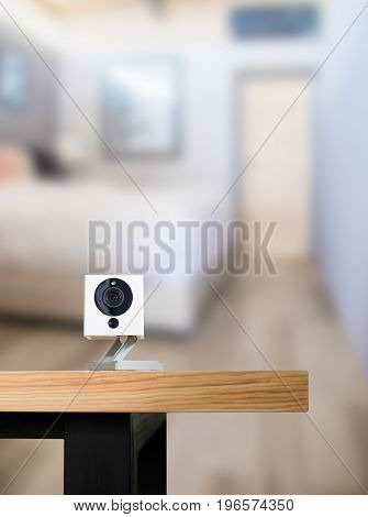 Security camera on Wood table. IP Camera.View of a modern living room background