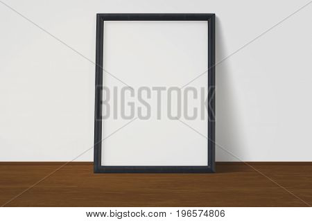 White poster with black frame mockup on wooden floor