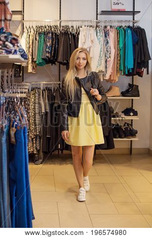 Concept Shopping. Portrait of beauty smiling woman in shop. Casual clothes