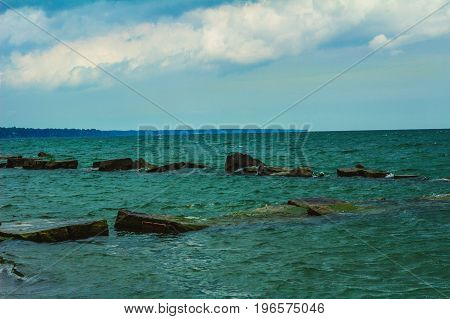 Large rocks sticking out of the water in Lake Erie.