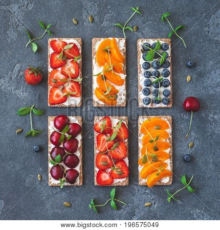 Snack with crispbread cream cheese and fresh fruits. Healthy food concept. Flat lay top view