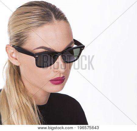 Portrait of a girl wearing black fashionable sunglasses