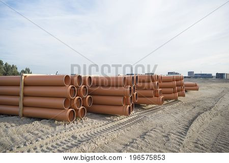 stack of pvc pipes on a construction site