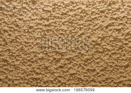 Gold hammered metal backgroundabstract metalic texture sheet of metal surface painted with hammer paint