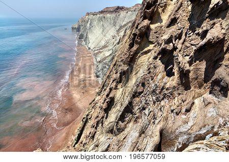 Rocks and sea Persian Gulf Iranian Island of Hormuz Hormozgan Province southern Iran.