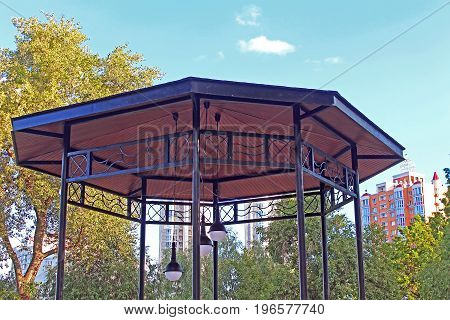 Top view of arbor with modern lamp in Natalka park in Kyiv, Ukraine