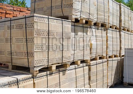 Large number of pallets of yellow brick