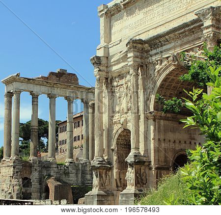 Arch of Emperor Septimius Severus and Temple of Saturn at the Roman Forum in Rome, Italy
